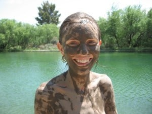 Jaya indulging in a mud bath at Eden Hot Springs. The Big Pool in the background.